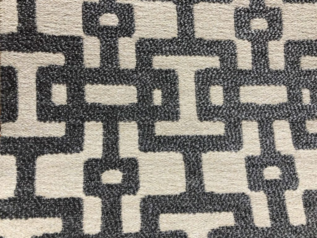 Stof met geometrische print. In grijze beige kleur