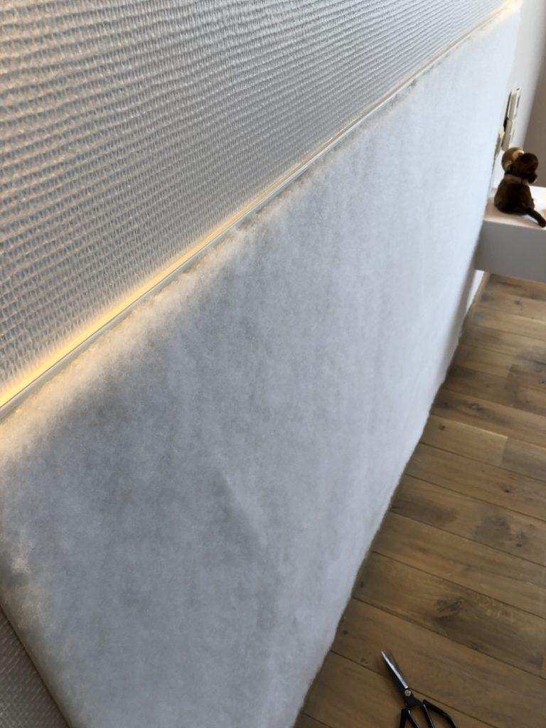 Dacron op muur bevestigd
